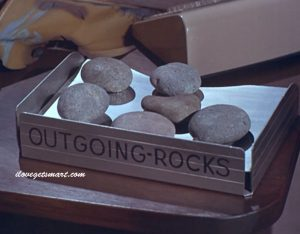 Outgoing rocks from Control's Inter office top secret relay. Did one come crashing through your picture window? No worries - just plunk it in a mailbox. Control's address is on it.