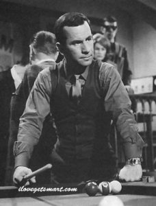 "Maxwell Smart takes to the pool table in ""The Dead Spy Scrawls."" Squint and you can see Mr. Spock over his shoulder."