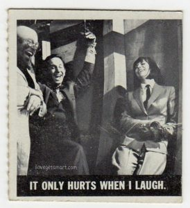 This Get Smart trading card shows a scene from Mr. Big that we didn't get to see. Here we see Max and 99 dealing with the effects of laughing gas. It may be worth noting that the person on the left is supposed to be Professor Dante, although he doesn't exactly look like actor Vito Scotti in this shot.