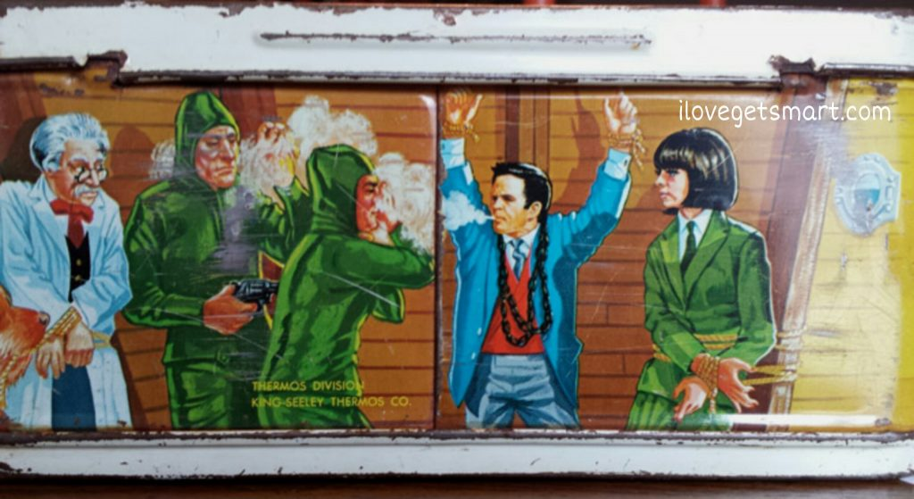 The bottom of the Get Smart lunch box shows a scene that was intended for Mr. Big, but didn't make the cut. Max fights Kaos with cigarettes rather than the Inflato coat.