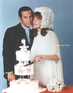 "Max and 99 cut the wedding cake - a cake we didn't see in ""With Love and Twitches."""